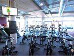 The cardio zone includes treadmills, rowers, cycle bikes,