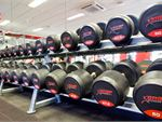 Fully equipped free-weights area with dumbbells up to
