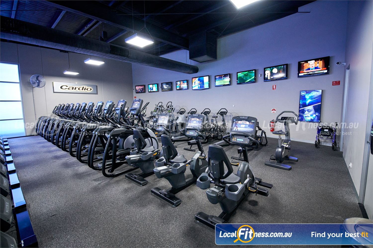 Fitness First Glen Waverley Rows of cardio machines including cross-trainers and recumbent cycle bikes.