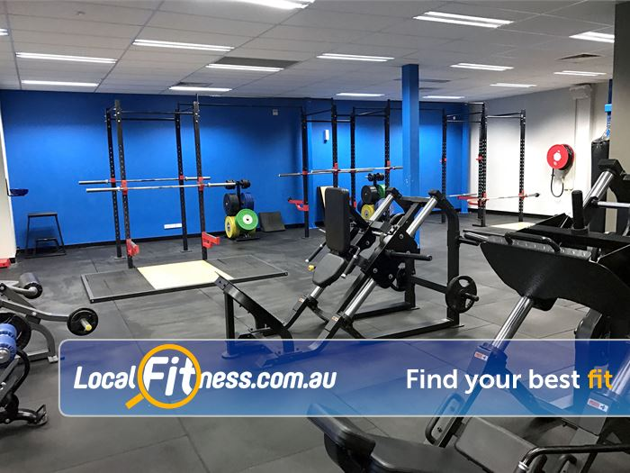 Genesis Fitness Clubs Belmont Enjoy free-weight training with heavy duty plate loading machines.