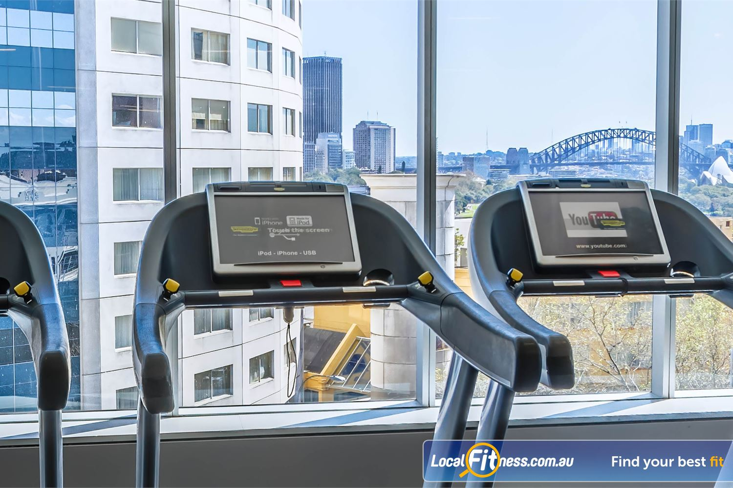 Fitness First Platinum Kings Cross Near Rushcutters Bay Bright and spacious workout area with views of Sydney Harbour Bridge.