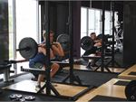 Our Harrison gym includes heavy duty lifting racks.