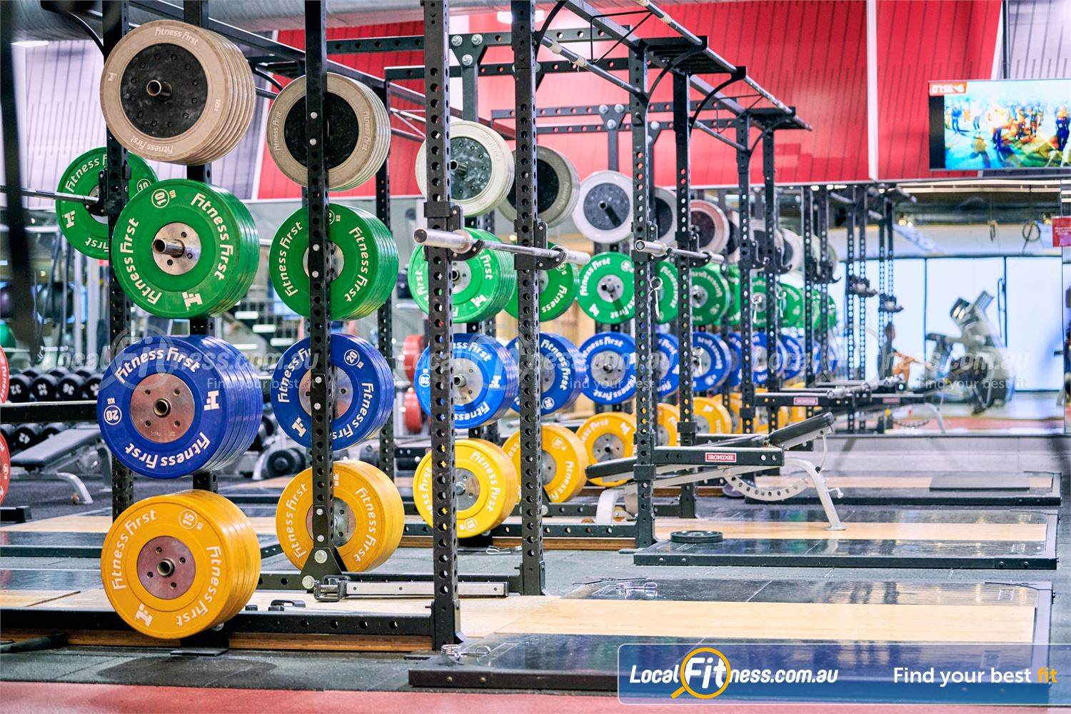 Fitness First Near Yarralumla High-performance strength cages with Olympic lifting platforms.