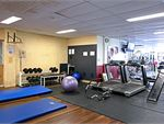 Dedicated ab and stretching area with fitballs, mats