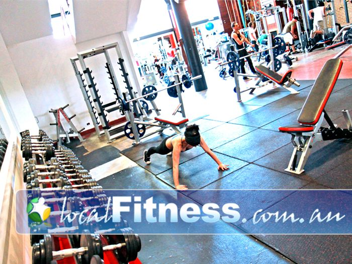 Total Body Conditioning Gym Near Moore Park Our spacious and non-intimidating free-weights area.