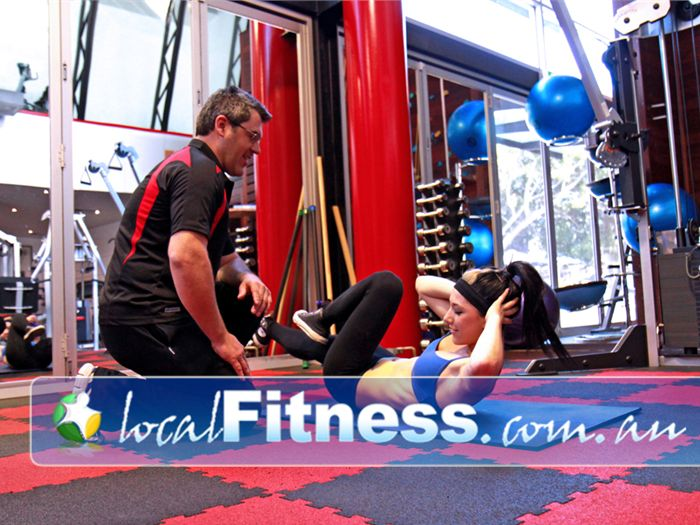 Total Body Conditioning Gym Waterloo Work those abs in our abs and stretch area.