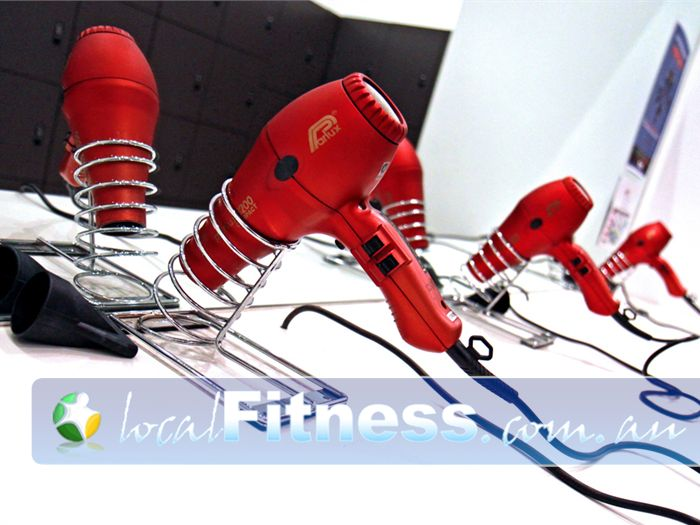 Total Body Conditioning Gym Near Moore Park Unisex grooming area with hair dryers and straighteners.