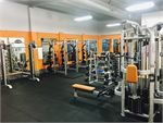 The fully equipped free-weights area at Plus Fitness