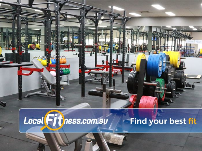 Genesis Fitness Clubs Near Murrumba Downs The heavy duty strength zone with multiple lifting racks and deadlift platforms.