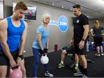 Strength and conditioning classes using kettlebells, weights, sleds,
