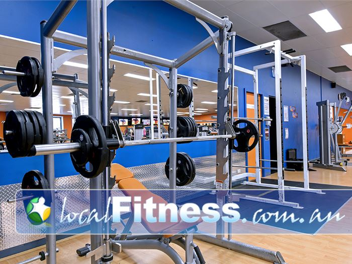 Plus Fitness Health Clubs Near Elderslie Fully equipped for strength training with multiple racks.