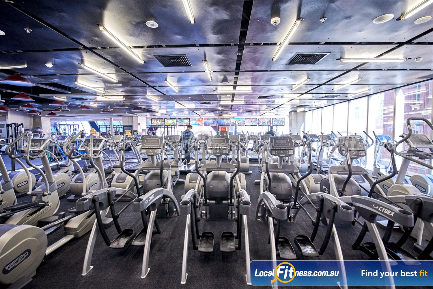 Fitness First QV Platinum Near East Melbourne Rows of state of the art treadmills and cross-trainers.