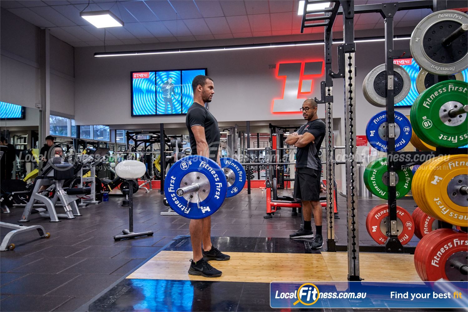 Fitness First Near Kellyville High-performance strength cages with Olympic lifting platforms perfect for deadlifts.