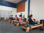 Experience our intimate Underwood Reformer Pilates classes.