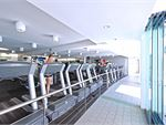 The cardio area overlooks our stunning outdoor pool