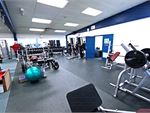 The gym area includes dumbbells, barbells and more.
