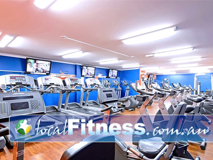 Plus Fitness 24/7 Near Camden Rows of cardio machines accessible 24 hours a day.