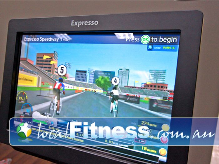 Genesis Fitness Clubs Near Reservoir Interactive game style playing with Expresso cycle bikes.