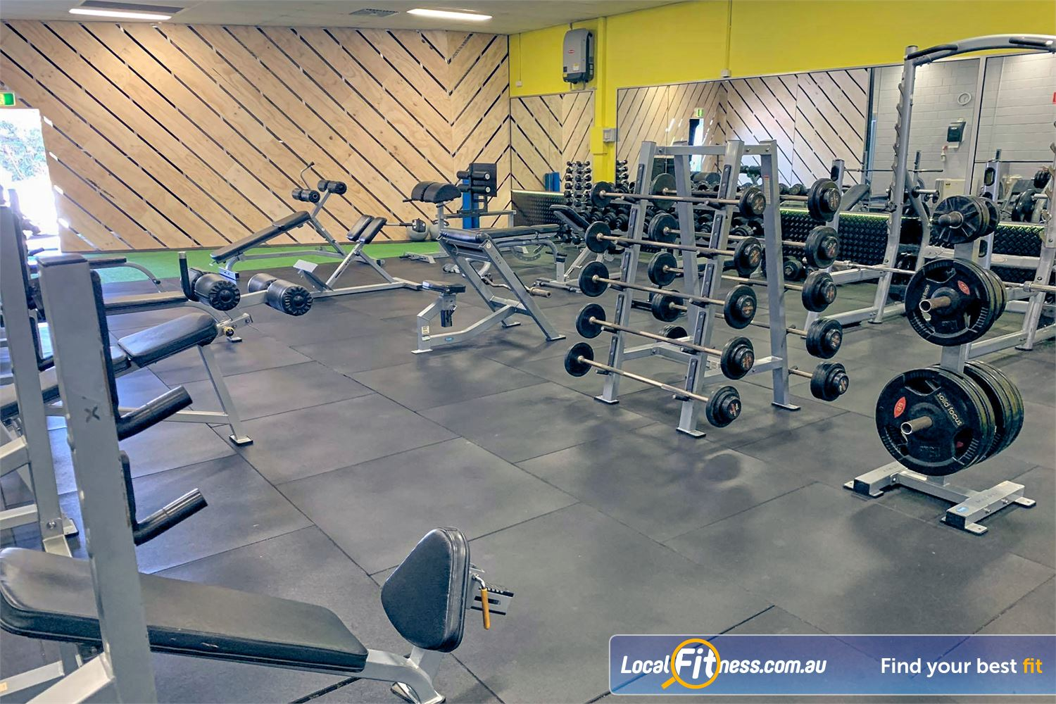 Culture 24:7 Near Greenwood Fully equipped free-weights area with dumbbells, barbells, benches and more.
