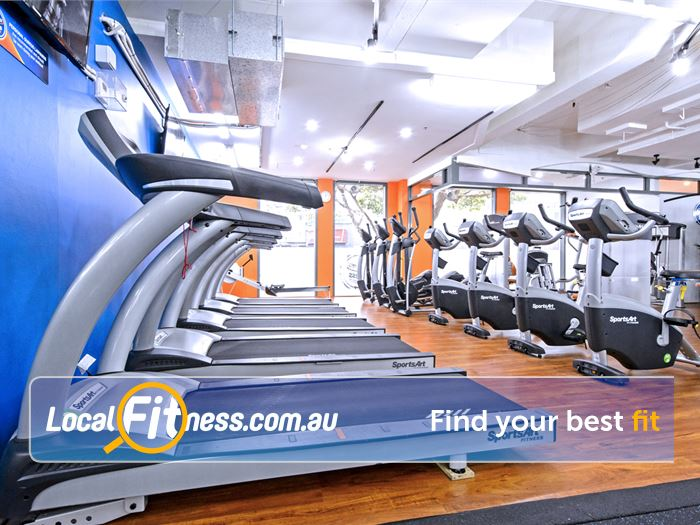 Plus Fitness 24/7 Near Strawberry Hills Rows of cardio machines accessible 24 hours a day.