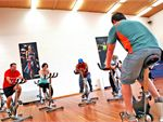 Spin A group cycling class combining various motivational and sport psychology