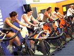 Spinning Stationary indoor cycling class. Basic cycling movements, 55 minutes of