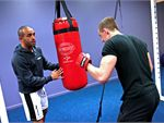 Box Circuit A boxing style workout incorporating impact and circuit training to