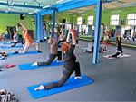 Pilates A comprehensive system of exercise movements designed to strengthen &