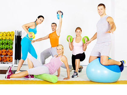 Energise & Tone Fun, dynamic circuit class in group fitness room utilizing varied